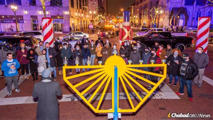 Young Jewish professionals gathered for the lighting of the menorah at the historic Monument Circle in Indianapolis, steps away from the Indiana Statehouse. A second lighting took place in the Indiana capital at the Statehouse itself.