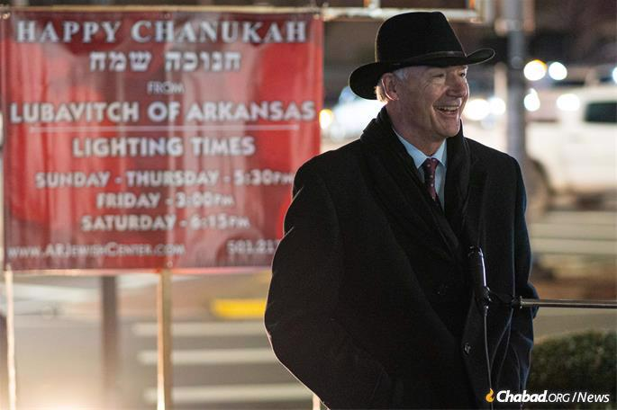 Arkansas Gov. Asa Hutchinson stands in front of the giant menorah in Little Rock, placed by Lubavitch of Arkansas. (Credit: Randall Lee)