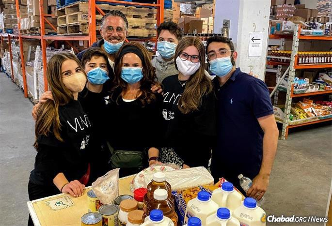 Volunteers, including singles, couples and entire families make the work of The Family Store in Montreal possible.