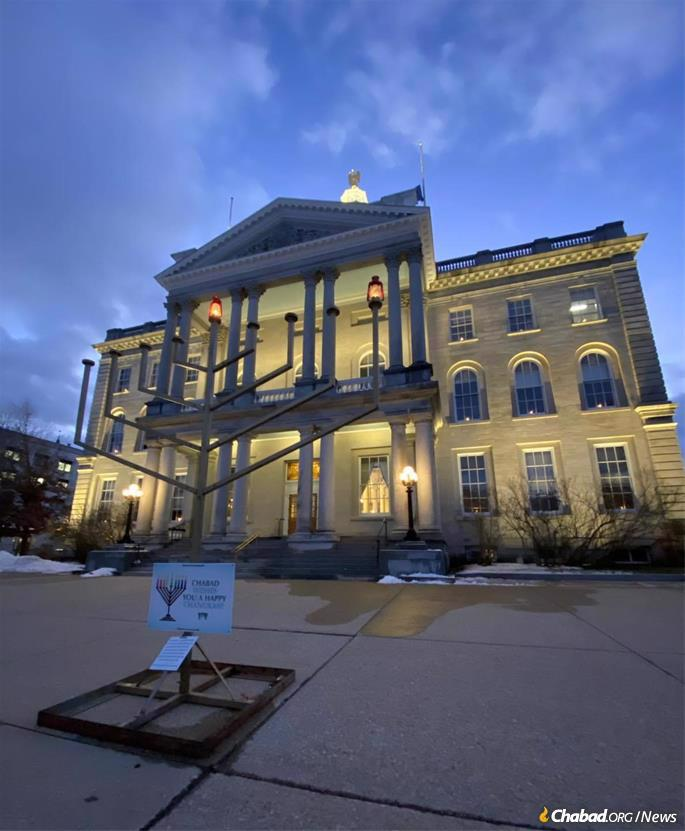 A menorah stands at the New Hampshire State House, placed by Chabad-Lubavitch of New Hampshire.