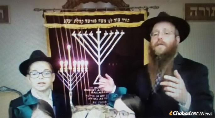 Chabad-Lubavitch Rabbi Yosef Wolvovsky of Chabad in Glastonbury, Conn. speaks during a virtual menorah-lighting ceremony with Connecticut Governor Ned Lamont organized by Chabad-Lubavitch of Connecticut.