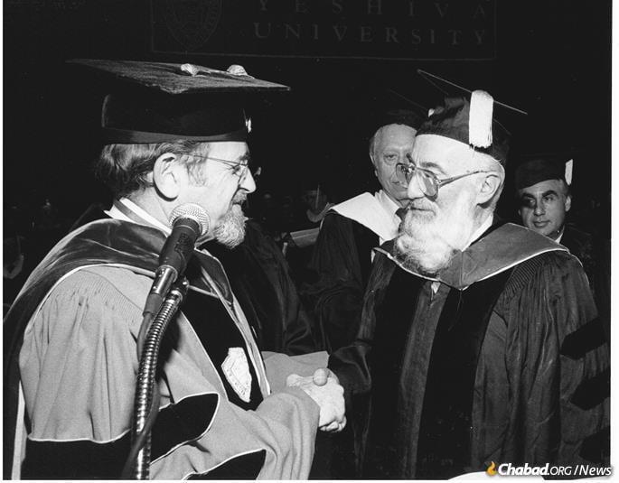 Rabbi Norman Lamm confers an honorary degree from Yeshiva University upon Rabbi Schwartz in 1990.
