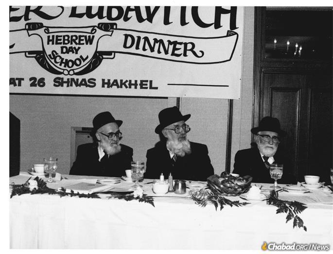 Rabbi Israel Karno, Rabbi Gedalia Dov Schwartz and Rabbi Yehuda Goldman at a Cheder Lubavitch dinner