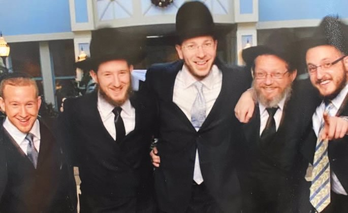 Lida's son Gregory, and her three grandsons, Eric, Nathan and Motti, with Rabbi Weinstein.