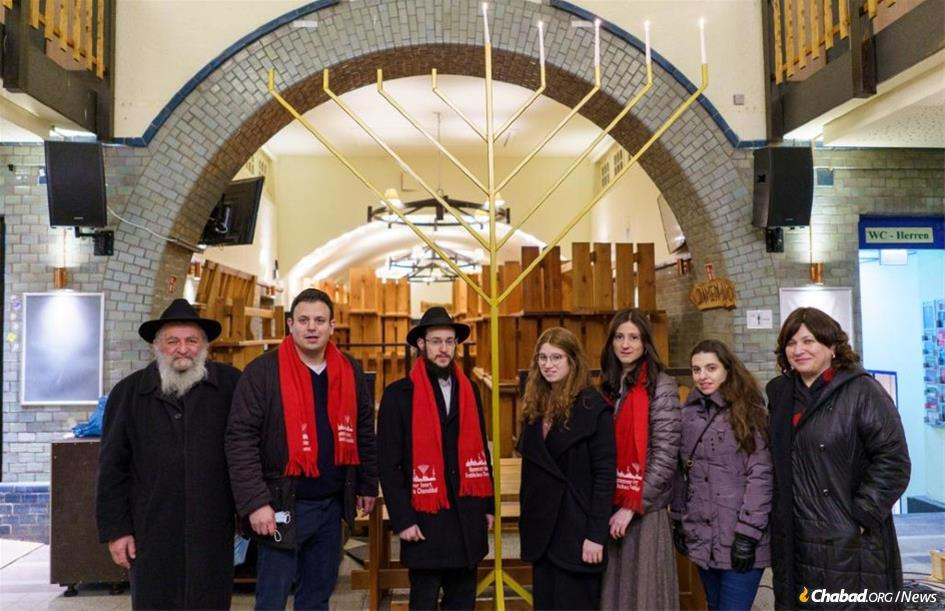 Shterna Wolff, third from right, at the menorah-lighting in Hanover, Germany, flanked by family and community leaders.