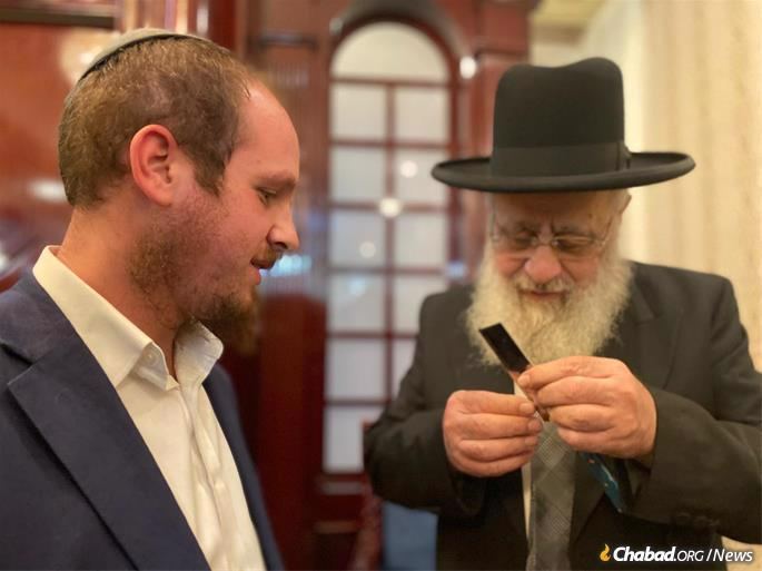 "While in the UAE, the chief rabbi inspects a ""chalef,"" the traditional knife used for kosher slaughter. Kosher food is becoming more and more available in the Emirates."