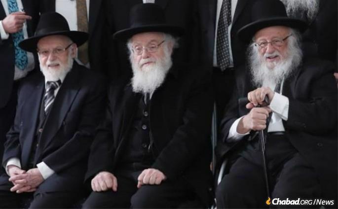 Rabbi Shalom Povarsky, center, with his brothers, Dr. Chaim Povarsky, left, and Rabbi Boruch Dov Povarsky.