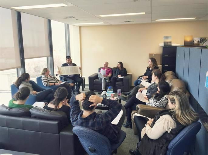 Markowitz gives a Torah class to young adults working in various departments of Federation CJA in Montreal, also before the pandemic.