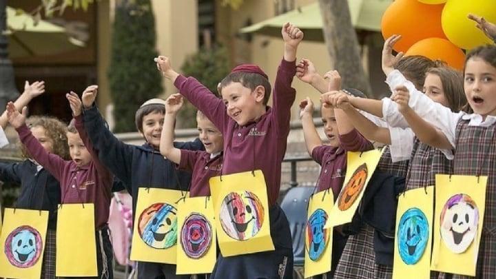 mitzvah Day 2nd grade smiles.jpg