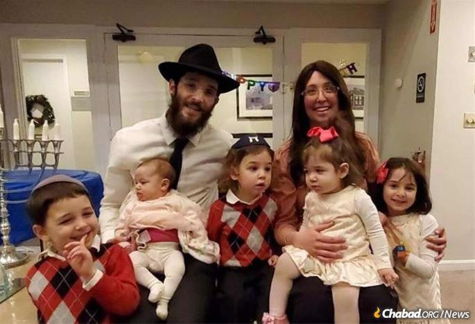 Rabbi Levi and Mushky Lezell, co-directors of Chabad of the South Shore, and their children