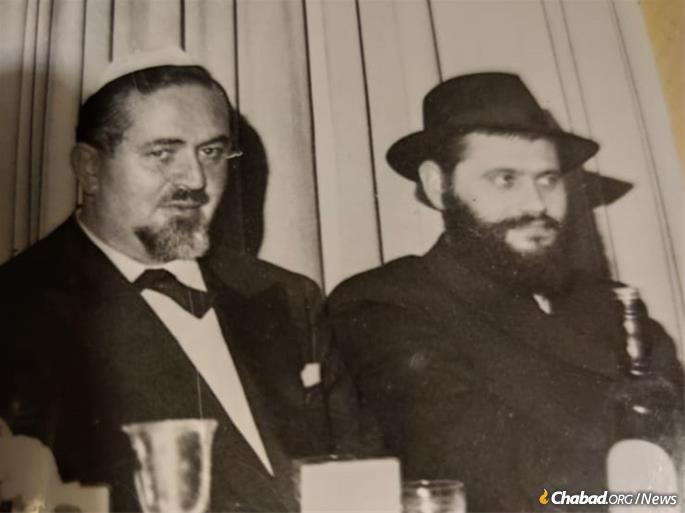 Avraham Zippel, one of the four Zippel brothers who played a key role bringing the Gareliks to Milan and sustaining Jewish life there for decades, sits alongside Rabbi Garelik at a family gathering. Credit: Zippel family.