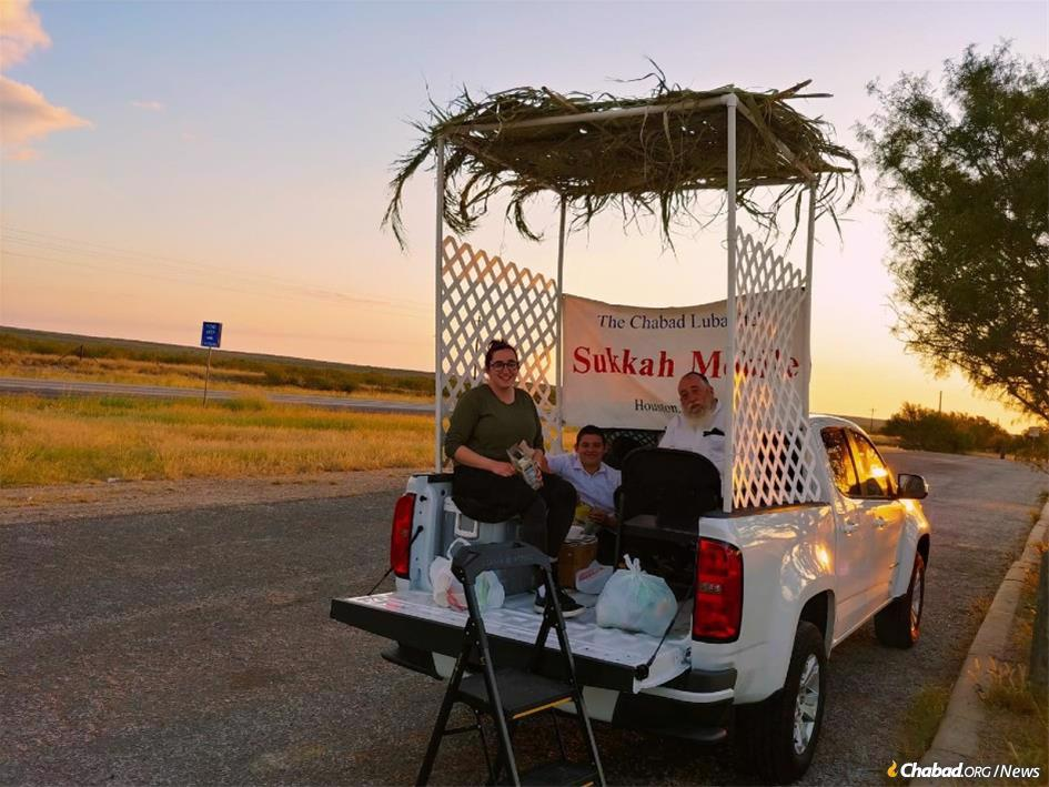 Rabbi Saadya and Chaya Sara Kaufmann have a congregation in rural Texas spread out over more than 40,000 square miles. Here, the rabbi's sister-in-law Mushka Nathanson, his father-in-law R' Reuven Nathanson and his son Mendel help out during Sukkot.