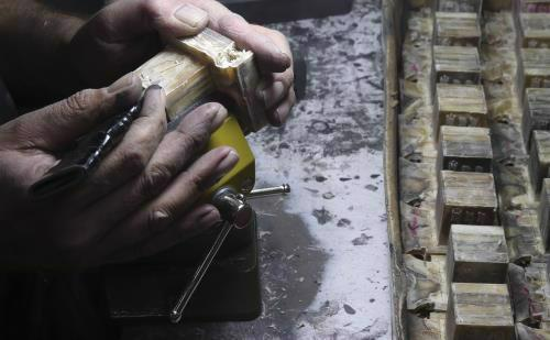 """Teffillin boxes being crafted by a """"batim-macher"""" - crafter of boxes. While the texture looks and feels quite similar to wood, they are in fact made of leather."""