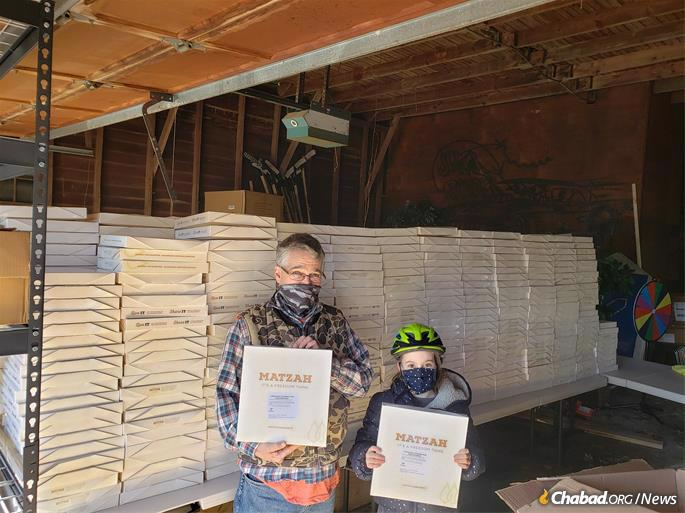 Matzah-packing and distribution at Chabad of Olney, Md., which with the help of community volunteers will provide some 1,000 households with shmurah matzah. (Credit: Chabad of Olney)