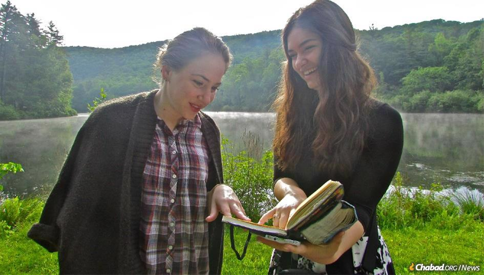 Esther Makarov and Zahava Angster delve into topics of Chabad philosophy together during their break at Bais Chana's winter program in the Berkshires.