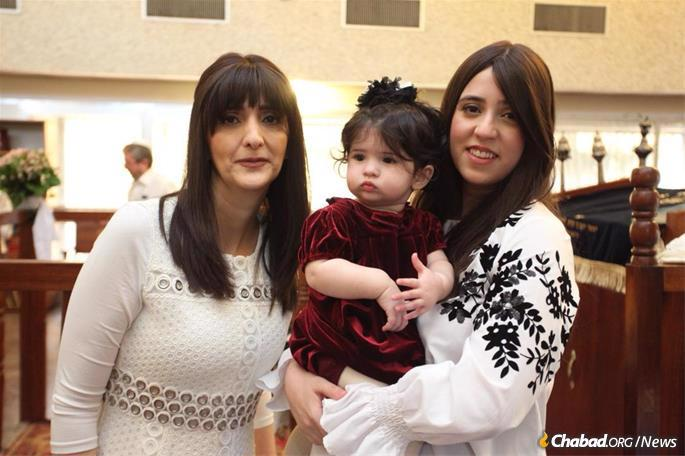 Bentolila (left) with her daughter, Bensaid, and granddaughter at her grandson's brit milah in Kinshasa. Her daughter and son-in-law today lead Chabad of Ivory Coast in Abidjan. (Credit: Bentolila family)
