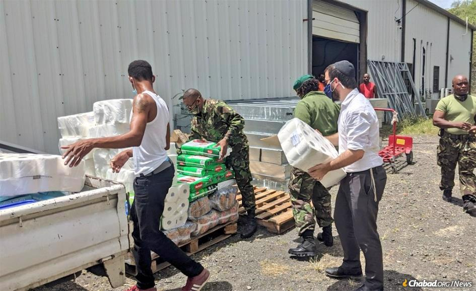 Rabbi Avraham Super prepares relief supplies for thousands of residents of nearby islands impacted by the volcanic eruption on St. Vincent.
