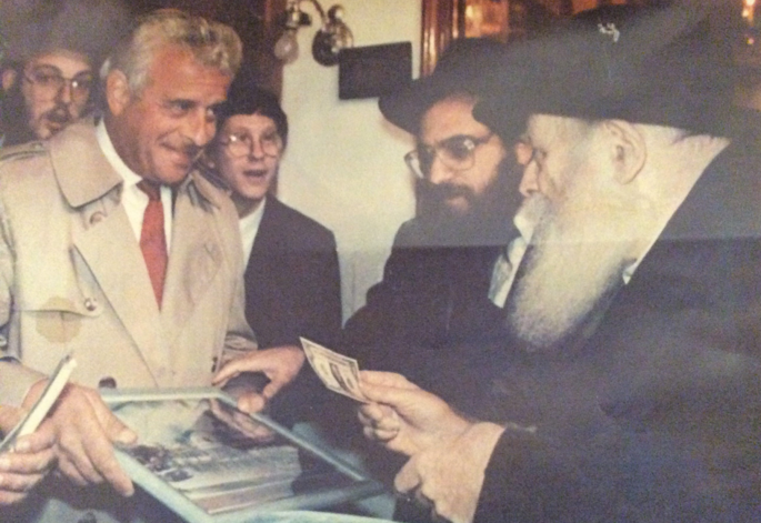 Mr. Paul Sussman bringing the Rebbe the renderings of the new Chabad Hallandale Center in 1992 with Rabbi Raphael Tennenhaus.