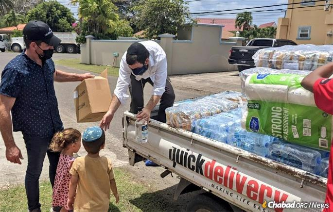 Super arranges a relief delivery and his children lend a hand.