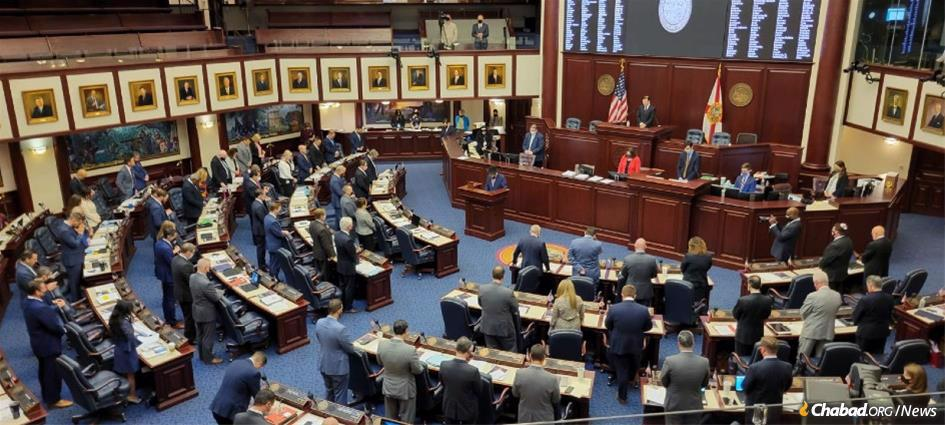 The Florida Legislature passed a bill requiring that public-school students be given a brief period to pause and reflect as they begin each school day. Rabbi Shneur Zalman Oirechman, center, led the Florida House in prayer earlier this year.