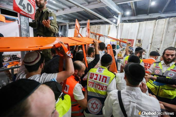 Workers from emergency medical services organizations across Israel assist at the mass-casualty scene in Meron during the Lag BaOmer holiday on April 30. (Photo: David Cohen/Flash90)