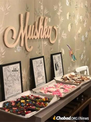 When Rabbi Yosef and Devorah Wilhelm celebrated the bat mitzvah of their daughter Mushka, Armet was there with her chocolate, making artisanal bark chocolate that featured women in Jewish history.