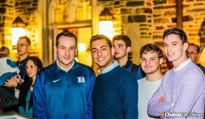 Josh Berman ('23), far right, who serves as president of Chabad at Duke Undergrad, with Duke's famed basketball coach, Mike Krzyzewski