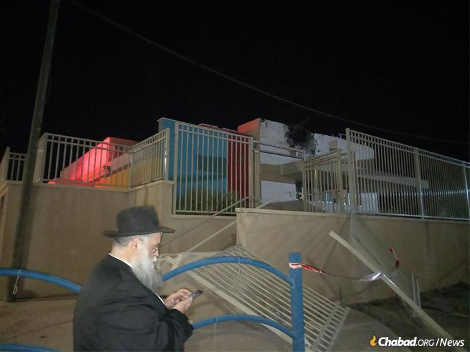 Rabbi Moshe Zeev Pizam, director of Chabad of Sderot, surveys the damage at the school.