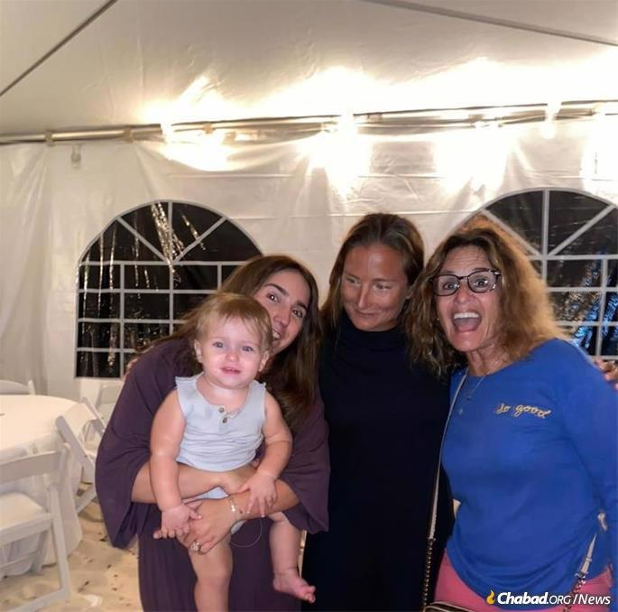 Jill Swann (right) has found Jewish community and celebration at the new Chabad House in Turks and Caicos.