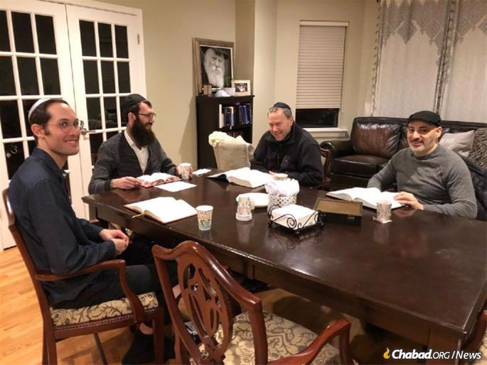 Hurwitz, left, at a Torah- study class at the home of Rabbi Yoel Wolf, second from left, in the Rogers Park section of Chicago.