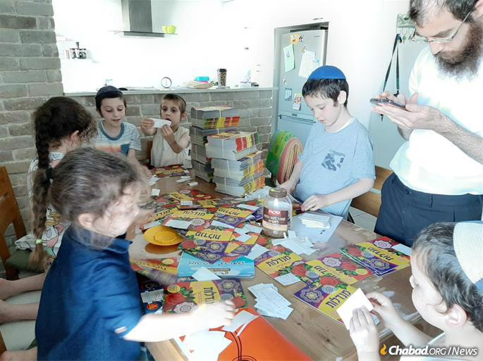 The Chabad Young Professionals community of the UES has sent Shavuot gifts for 1,000 children living in Mazkeret Batya, Israel, and hopes to find more ways to connect and uplift the village's beleaguered population.
