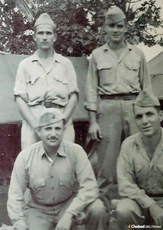 Haller, lower left, with fellow Marines.