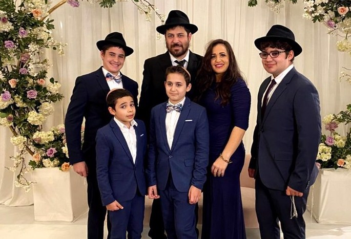 Rabbi Shmuel Novack, David Novack's grandson, helped in the effort. He is pictured here with his wife, Chana, and family.