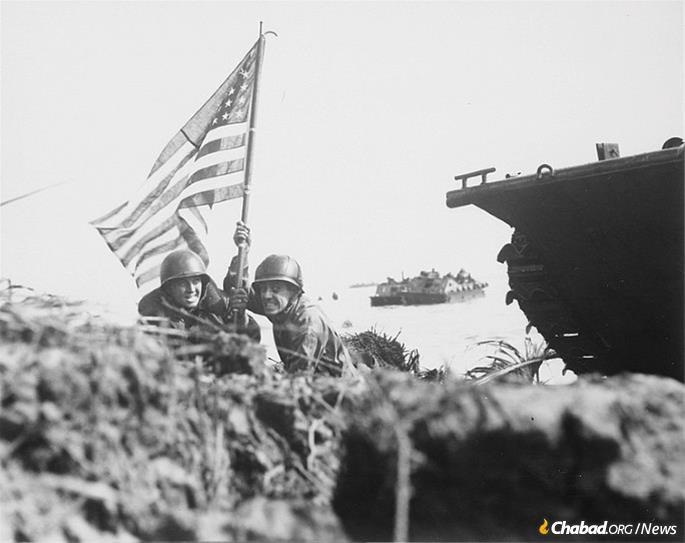The first U.S. flag to be planted on Guam, 1944.