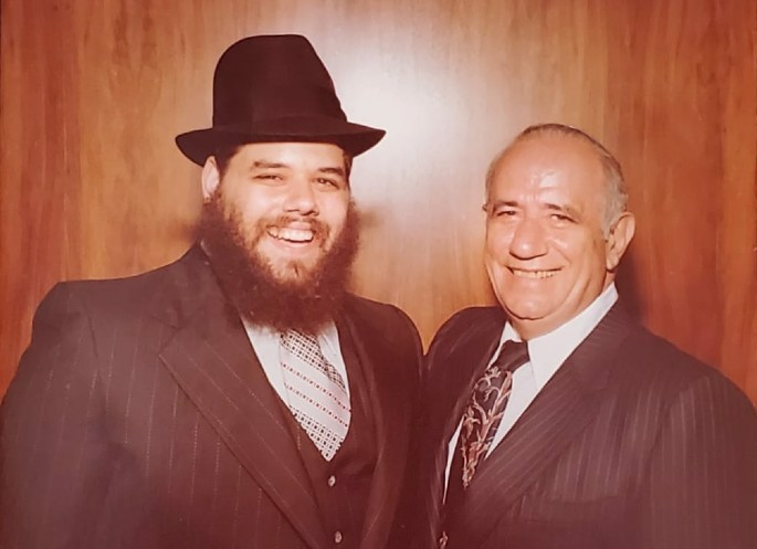 Rabbi Novack's father, Bentzion Novack, left, and his grandfather, David Novack, right