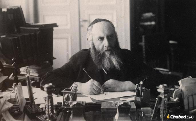 Rabbi Yosef Yitzchak at his desk, writing (Riga, 1929).
