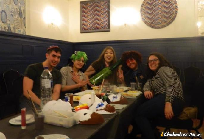 Arielle Firestone, center, says that studying in Scotland, far from her hometown of New York City definitely had its challenges, but Chabad opened their hearts to her and her fellow Jewish students