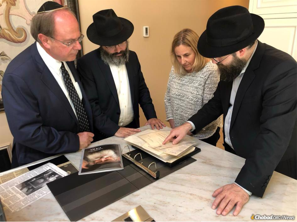 On June 13, 2021, or 3 Tammuz 5781, Leonard Holtz discovered a rare, handwritten Holocaust-era letter written by the Rebbe, Rabbi Menachem M. Schneerson, of righteous memory, in his basement. The discovery was made on the 27th anniversary of the Rebbe's passing and 80 years since the letter's writing. (From left: Leonard Holtz, Rabbi Avraham Berkowitz, Laura Zimmerman and Rabbi Yirmi Berkowitz.)