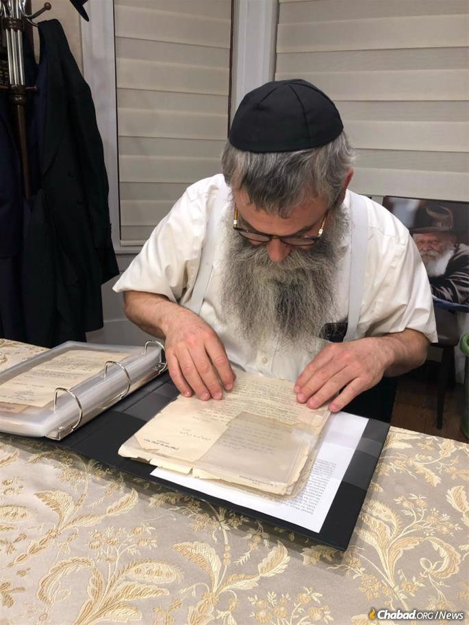 Rabbi Chaim Shaul Brook, director of Vaad Hanachos B'Lahak (Lahak), consults the letters after their arrival on Wednesday evening. He and his team worked for days straight to prepare the materials for publication.