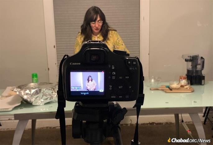 Despite the challenges during the pandemic, the Elkans remained close to school's Jewish students. Devorah Elkan, above, hosts an online challah-baking workshop.