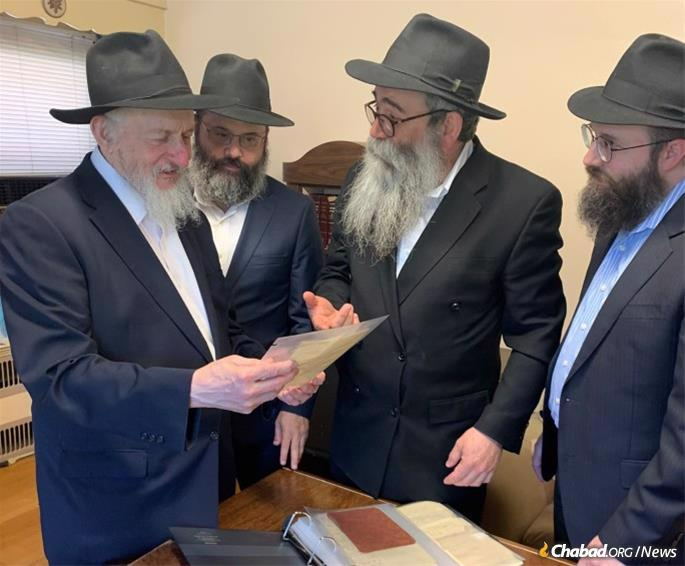 On June 17, nearly 80 years to the day since the Rebbe wrote the letter, it was presented to the Chabad Library on behalf of the Holtzes. (From left: Rabbi Sholom Dovber Levine, chief librarian; Rabbi Avraham Berkowitz; Rabbi Chaim Shaul Brook of Lahak; and Rabbi Yirmi Berkowitz of the Kehot Publication Society.)