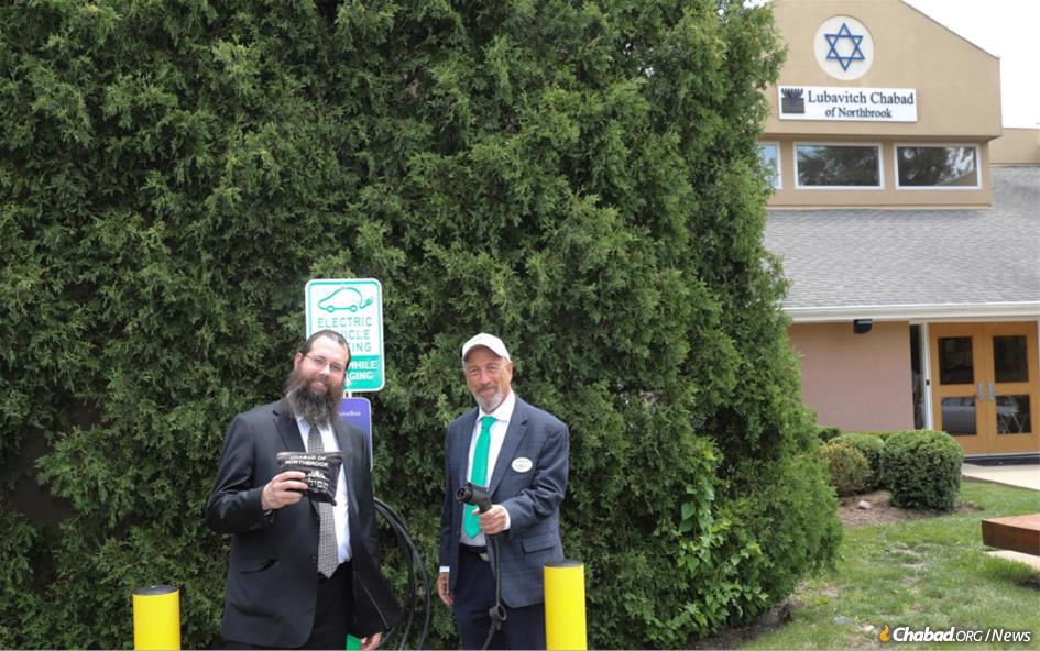 Rabbi Meir S. Moscowitz with George Groner, an energy entrepreneur who donated a charging station to Chabad of Northbrook, Ill.