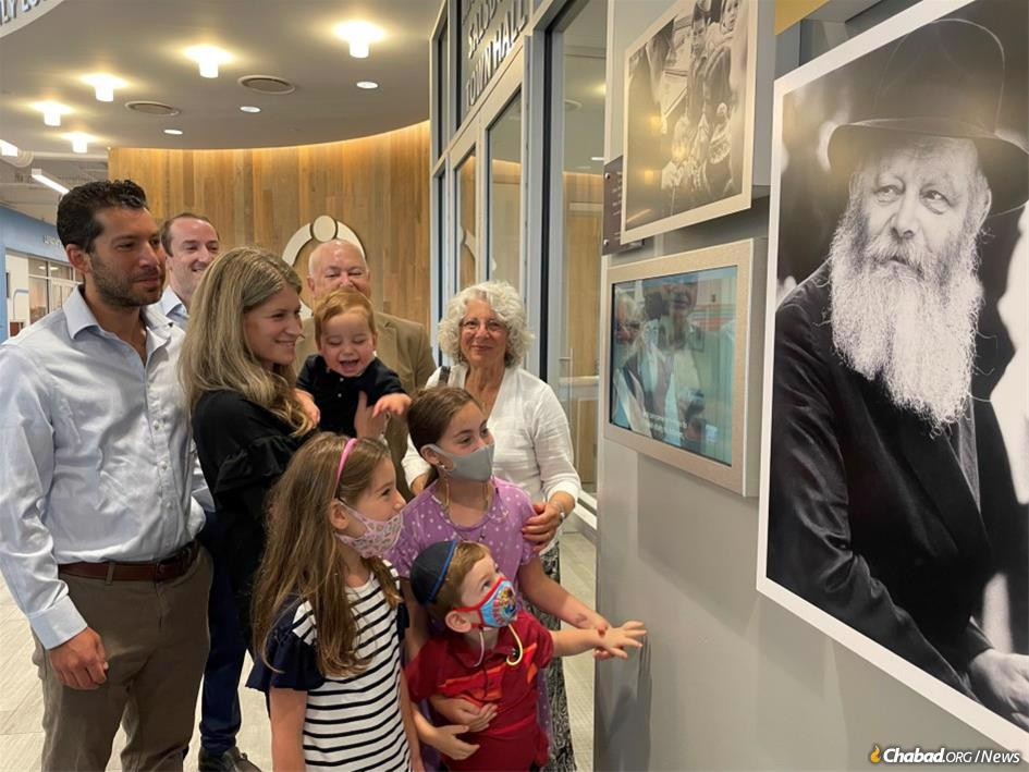 Visitors to LifeTown in Livingston, N.J., view a video and photo exhibit dedicated to the Rebbe.