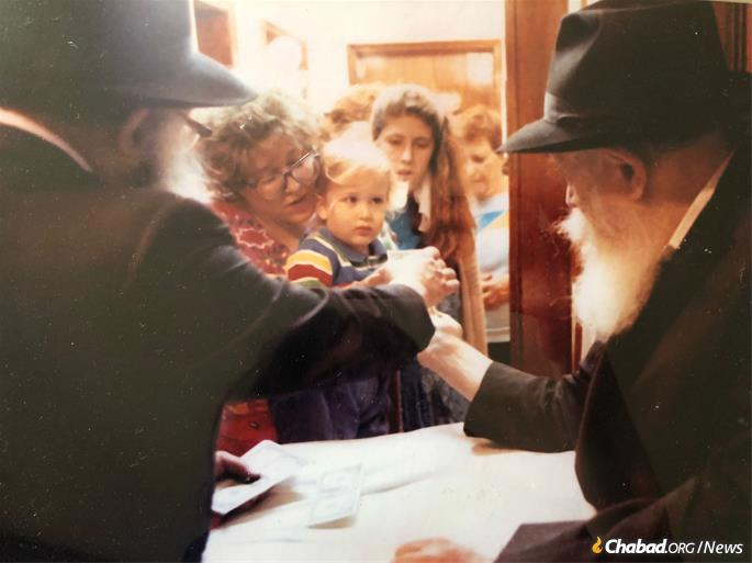 At every available opportunity, Bassman and her children would queue up with thousands of others to receive a dollar and a blessing from the Rebbe.
