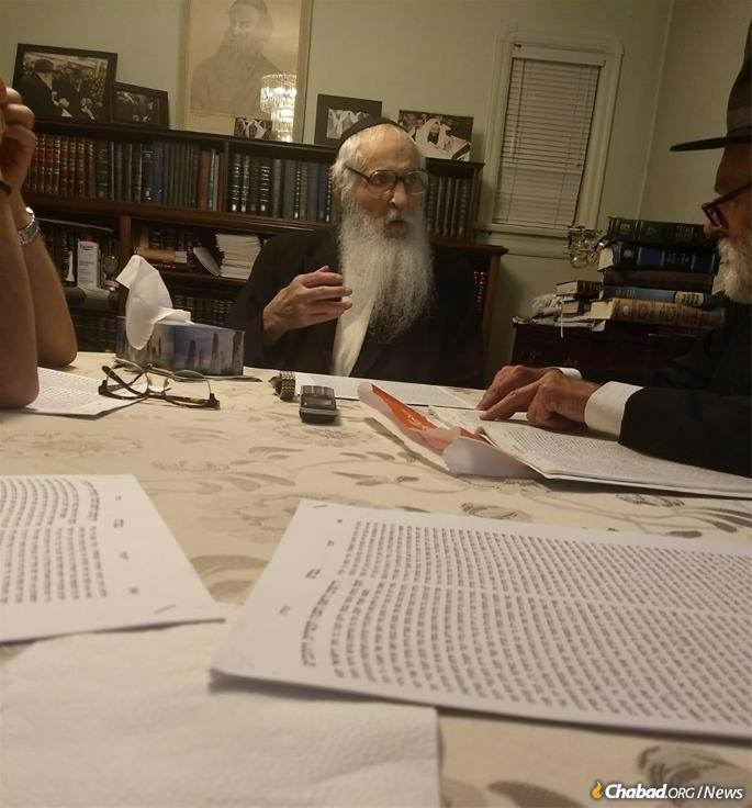Giving a class in Likkutei Torah shiur in his home in recent years.