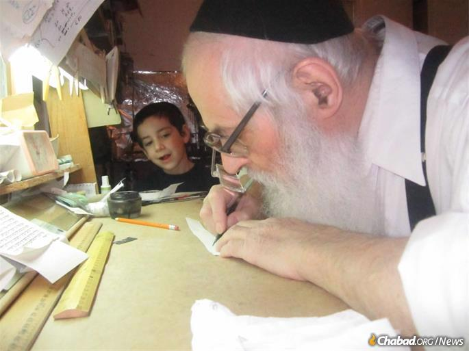 With a great grandson, Yakov Notik, at his sofer's table.