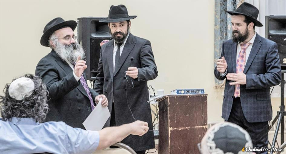 Rabbi Shlomo Noginski, center, who was stabbed eight times in an anti-Semitic attack, has proclaimed his resolve to train and ordain at least eight new rabbis.
