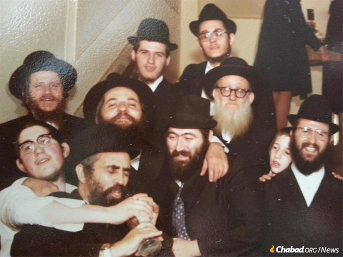 And the wedding of his daughter Brocha to Rabbi Nachman Wilhelm in Toronto, 1973, surrounded by Rabbis Zelik Aronow, Heshel Tzietlin, Mendel Aronow, Sholom Ber Kalmenson, Nachman Wilhelm, and Yosef Aronow.