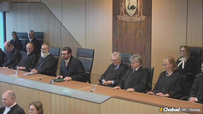 """At the welcome ceremony at the Supreme Court of Western Australia, on August 18, Rabbi Justice Marcus Solomon, seated third from left, said to the full court and distinguished guests that, """"In my Jewish studies, I had the good fortune of many great figures and mentors again, too many to name, but the occasion cannot pass without reference to the inspirational figure of the late Rabbi Menachem Mendel Schneerson, a man who inspired a generation savaged and shattered by the Holocaust. But Rabbi Schneerson did so with a global message of hope and a belief in reaching out to the goodness within humanity through kindness and love. It was a privilege to study in the institutions which he led."""""""