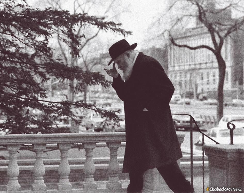 """In the spring of 1969 the Rebbe, Rabbi Menachem M. Schneerson, of righteous memory, announced publicly that it was contrary to Jewish law to abandon the Crown Heights neighborhood of Brooklyn or any other destabilizing Jewish community. The Rebbe is seen here entering the Central Chabad Library on Eastern Parkway in the mid-1970s; the Brooklyn Jewish Center, today Oholei Torah, looms in the background. (Photo: Shlomo Vishinsky   Courtesy Zev Markowitz / <a href=""""/5234467"""" target=""""_blank"""">Chai Art Gallery</a>)"""